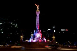 The Angel de la Independencia monument is lit up in blue, white and red, the colors of the French flag, following the Paris terror attacks, in Mexico City, November 14, 2015. REUTERS/Tomas Bravo